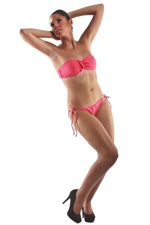 Beautiful Young Woman Wearing A Pink Bikini isolated on White Background. photo