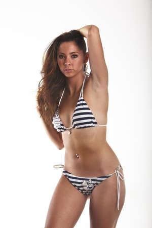 Beautiful Young Woman Wearing A blue Bikini isolated on White Background. photo