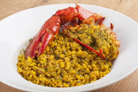 clawed: plate of Clawed Lobster with yellow rice