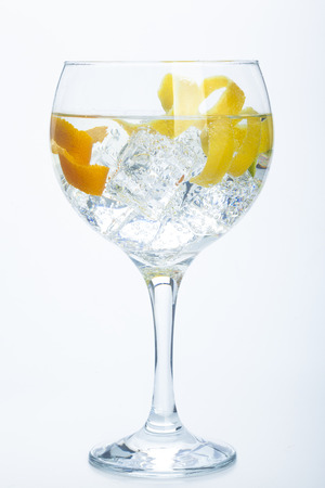 orange lemon and lime gin tonic isolated over white