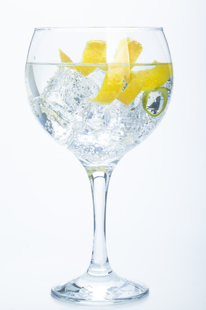 gin: orange lemon and lime gin tonic isolated over white background