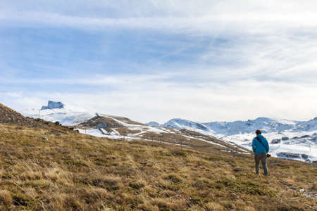 nevada: Sierra Nevada, Granada November 16, 2014: Man walking down the mountain to the peak in Sierra Nevada Veleta