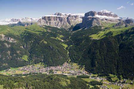 sella: Aerial view of Canazei and Fassa valley with Saas Pordoi mount (Sella group), Pordoi pass and Sella pass
