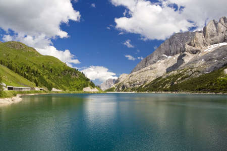 The artificial lake and pass of Fedaia (Dolomites, Trentino, Italy), at summer