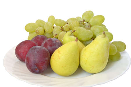 plate with plums, grapes and pears isolated on white background photo