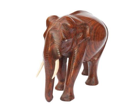 Wooden carved elephant isolated on white background photo
