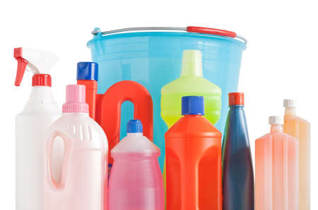 Colored plastic detergent bottles with bucket isolated on white background  photo