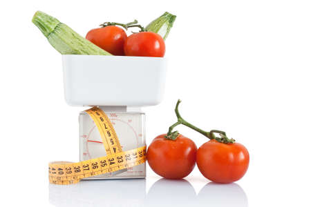 vegetables on kitchen scale with tape meter photo