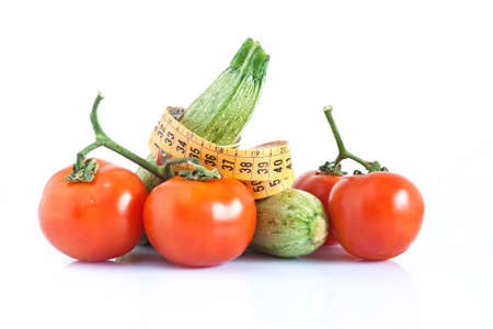 two courgettes and tomatoes with meter isolated on white background photo