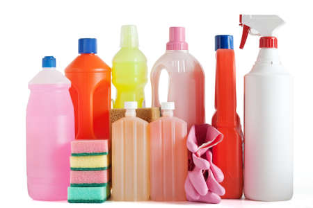Colored plastic detergent bottles with sponges and gloves Stock Photo