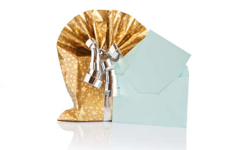 golden gift box with silver ribbon and green letter  photo