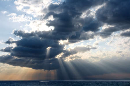 rays of sun through the clouds over the sea