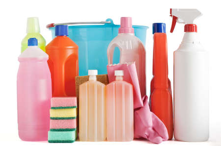Colored plastic detergent bottles with bucket, sponges and gloves Stock Photo