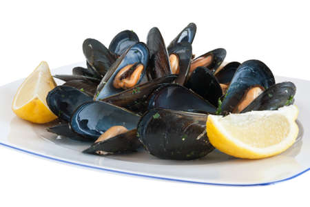 mussel: cooked mussels on a plate with lemon isolated Stock Photo