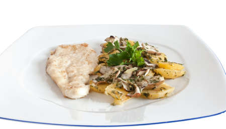 chicken escalope with baked potatoes and mushrooms isolated on white with clipping path photo