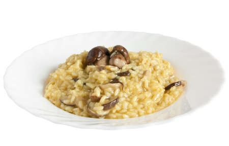 risotto: plate of risotto with mushrooms isolated on white