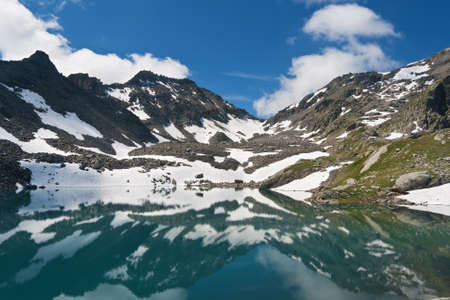summer view of Red Stone Lake, Aosta valley, Italy photo