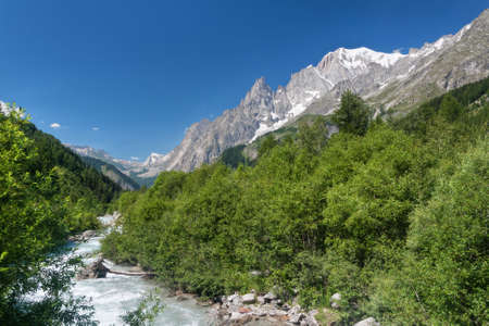 small stream in Ferret valley with Mont Blanc on background Stock Photo - 8510272