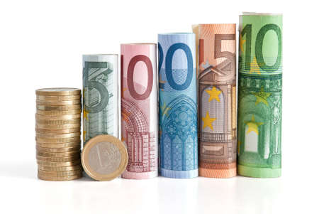 euro rolled bills, with one euro coin isolated  with clipping path Stock Photo