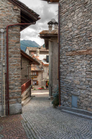 ancient homes and street in Verrand, Aosta Valley, Italy