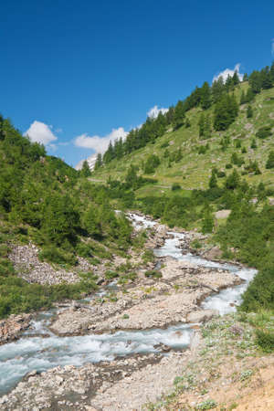 beautiful stream between rocks in Veny valley, Italy photo