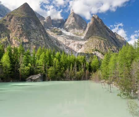 Green lake in Mont Blanc massif,  Italy Stock Photo