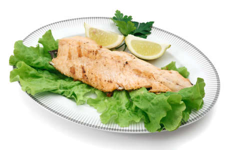 grilled salmon trout, lettuce and lemon isolated  photo