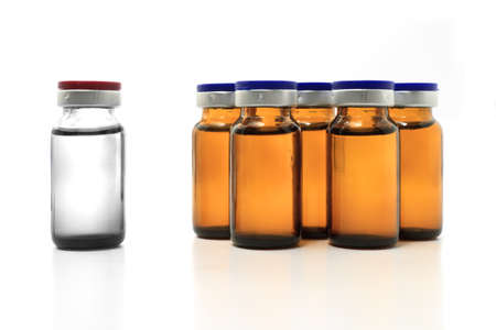 group of glass yellow bottles and a white one  Stock Photo