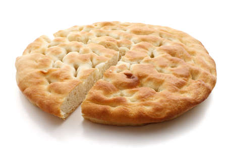 salty italian bread called focaccia over white background photo
