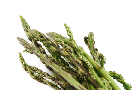 bunch of wild asparagus over white background photo