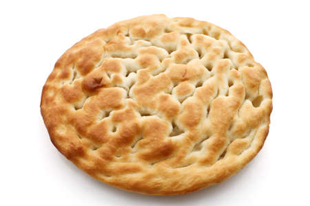 Typical salty italian bread called focaccia over white photo