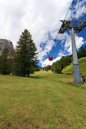 sud tirol: cablaway over meadow and wood in Italian Dolomites Stock Photo