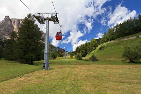sud tirol: cablaway over meadow in Badia valley, Italian Dolomites