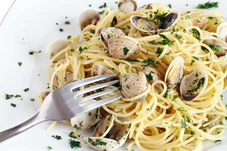 dish of spaghetti with clams and fork