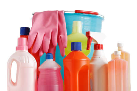 detergent bottles with bucket and gloves over white background Stock Photo