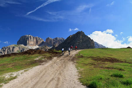 biker on high mountain road, Italian Dolomites photo