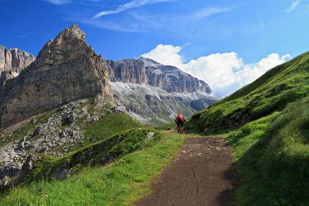 biker on high mountain road, Italian Dolomites photo