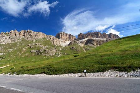 road in Pordoi pass beneath Sella Mountain photo