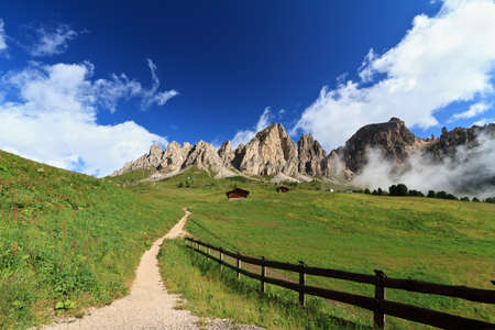 pathway in Gardena pass beneath Cir Dolomites mountain