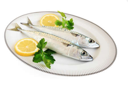 sardines: two mackerels with lemon and parsley isolated with clipping path