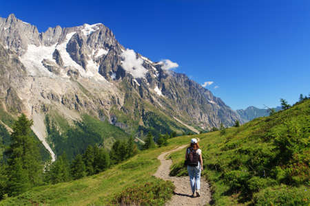 hiker in Ferret valley with Mont Blanc massif on background Stock Photo