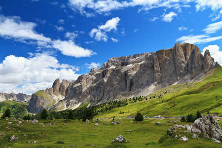 summer landscape of Sella mountain and Gardena valley from Sella pass, Italian Dolomites