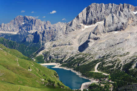 Fedaia pass with the characteristic lake on summer, Italian Dolomites
