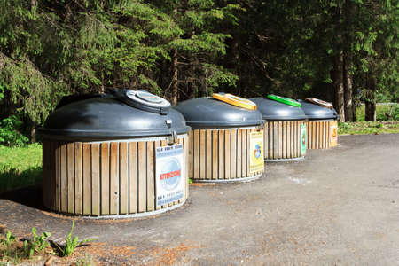 four wooden recycle bins for waste segregation  photo