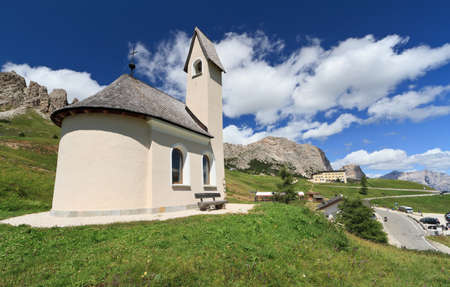 chapel beneath Cir Dolomites in Gardena pass, Italy photo