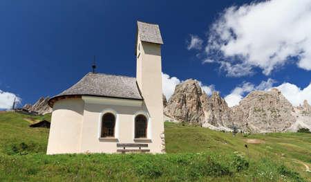 gardena: small chapel beneath Cir Dolomites in Gardena pass, Italy