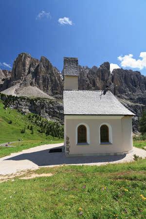 gardena: chapel  in Gardena pass, Italy  On background Sella mount