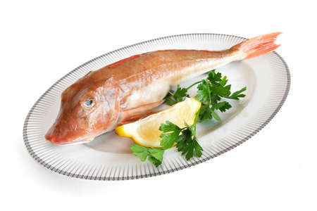 tub gurnard, lemon and parsley isolated with clipping path photo
