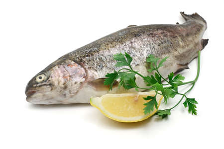 rainbow trout with lemon and parsley over white background Stock Photo - 17107658