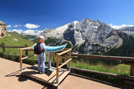 woman is watching mount Marmolada from a scenic spot photo